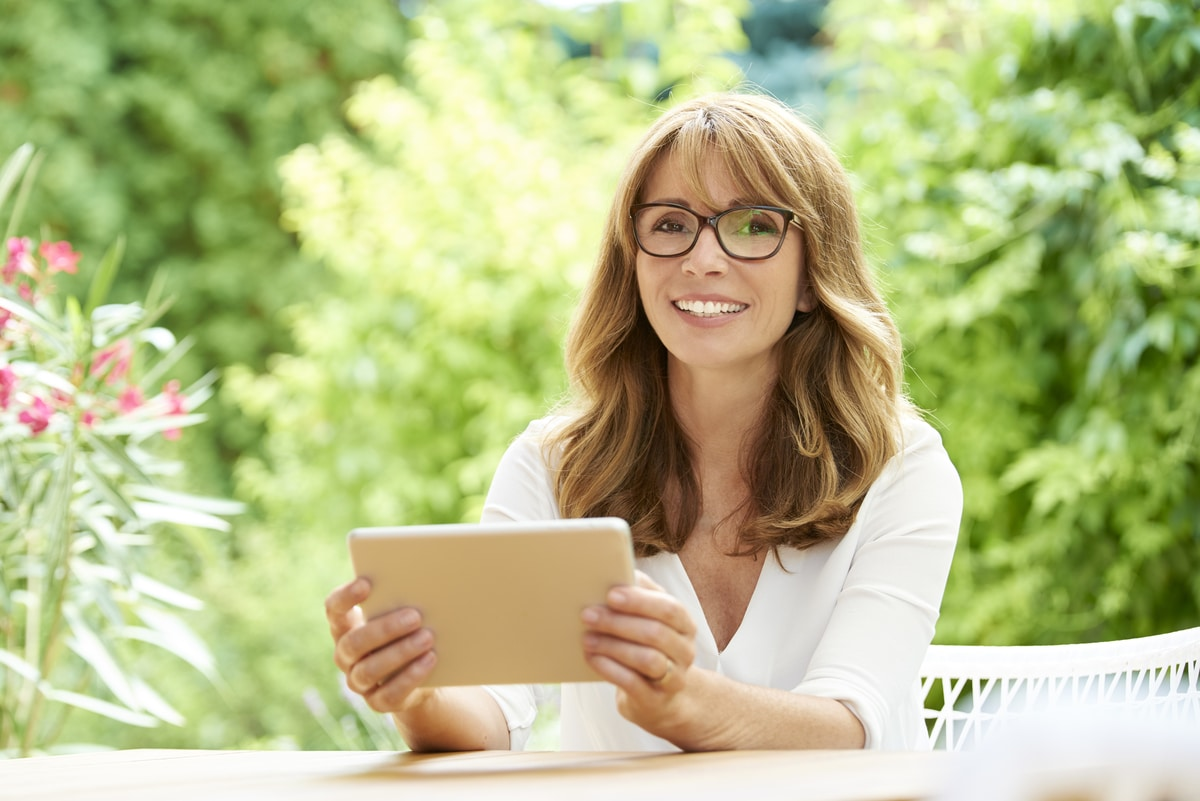 woman with tablet outdoors